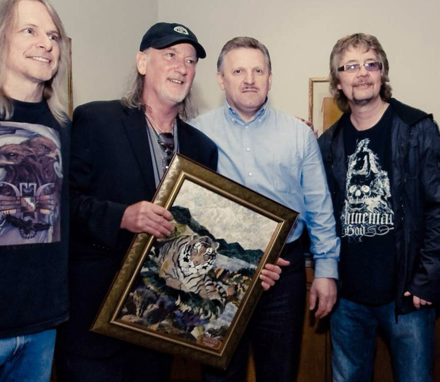 Rock band Deep Purple with our work. Left Steve Morse, Roger Glover work, governor V. Shport, Don Airey